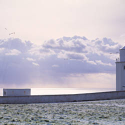 Lighthouse on a snow covered landscape, Lizard Lighthouse, Lizard Point, Cornwall, England