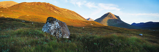 Lichen covered rock in a field, Glen Sligachan, Cuillins, Isle Of Skye, Scotland