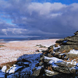 Rocks on a snow covered landscape, Great Mis Tor, Dartmoor, Devon, England