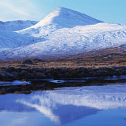 Reflection of snow covered mountains in a lake, Black Mount, Lochan Na h'Achlaise, Rannoch Moor, Highlands Region, Scotland