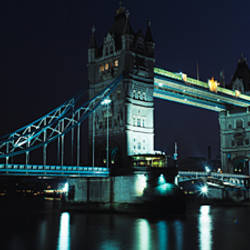 Bridge lit up at night, Tower Bridge, Thames River, London, England