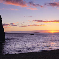 Silhouette of cliffs at dusk, Durdle Door, Jurassic Coast World Heritage Site, Dorset, England