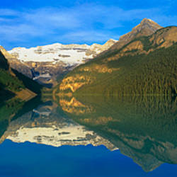 Reflection of mountains in water, Lake Louise, Banff National Park, Alberta, Canada