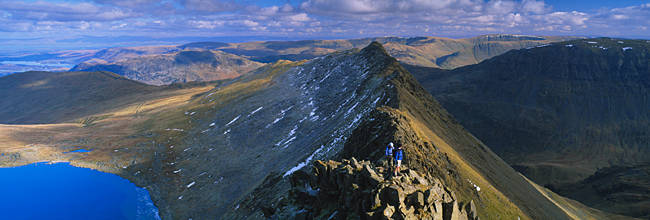 Hikers hiking on a mountain, Striding Edge, Helvellyn, English Lake District, Cumbria, England
