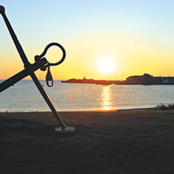 Silhouette of an anchor on the beach at sunrise, North Berwick, East Lothian, Scotland