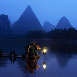 Fisherman fishing at night, Li River , China