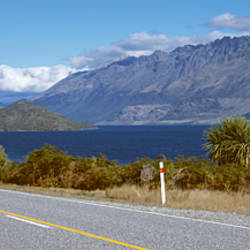 Road passing at the lakeside, Glenorchy, Lake Wakatipu, Otago Region, South Island, New Zealand