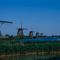 Traditional windmills at a riverbank, Kinderdijk, Rotterdam, Netherlands