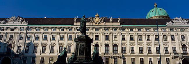 Low angle view of a statue in front of a palace, The Hofburg Complex, Heldenplatz, Vienna, Austria