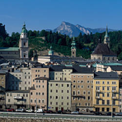 Buildings in a city with a fortress in the background, Hohensalzburg Fortress, Salzburg, Austria