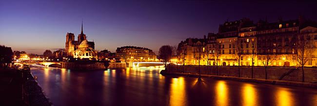 Buildings lit up at night, Notre Dame, Seine River, Paris, Ile-De-France, France