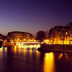 Buildings lit up at night, Notre Dame, Seine River, Paris, Ile-De-France, France