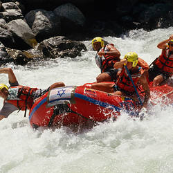 High angle view of four people rafting in rapid water