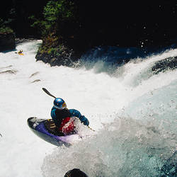 High angle view of a person kayaking in rapid water