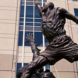 Low angle view of a statue in front of a building, Michael Jordan Statue, United Center, Chicago, Cook County, Illinois, USA