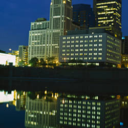 Buildings in a city lit up at night, Scioto River, Columbus, Ohio, USA