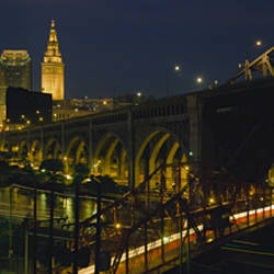 Arch bridge and buildings lit up at night, Cleveland, Ohio, USA