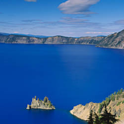 High angle view of a lake surrounded by mountains, Crater Lake National Park, Crater Lake, Oregon, USA