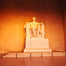 Low angle view of a statue of Abraham Lincoln, Lincoln Memorial, Washington DC, USA