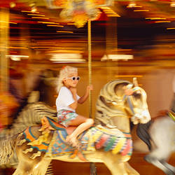 Side profile of a girl and a young woman sitting on carousel horses, Navy Pier, Chicago, Illinois, USA