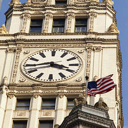 Low angle view of a clock tower, Wrigley Building, Chicago, Illinois, USA