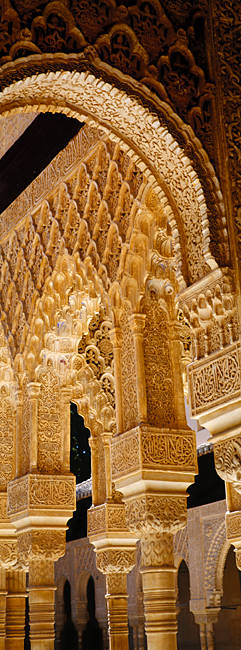 Low angle view of carving on arches and columns of a palace, Court Of Lions, Alhambra, Granada, Andalusia, Spain