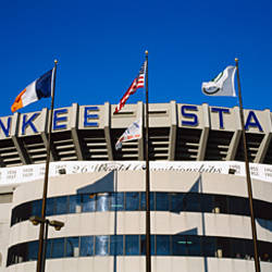 Flags in front of a stadium, Yankee Stadium, New York City, New York, USA