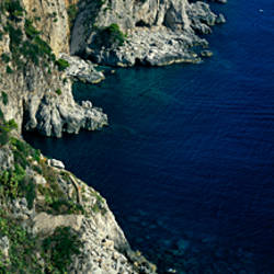 High angle view of rock formations on the coast, Faraglioni, Capri, Italy