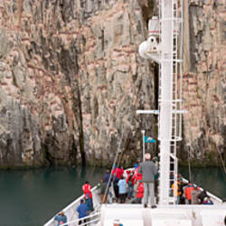Tourists on the bow of a sailing ship, Bear Island, Svalbard, Norway