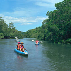 Group of people kayaking in coastal waterway, Costa Rica