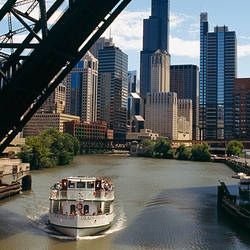 High angle view of a tourboat in a river, Chicago River, Chicago, Illinois, USA