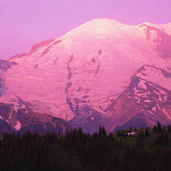 Snow covered mountain at sunrise, Mt Rainier, Washington State, USA
