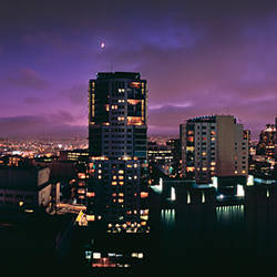 Buildings in a city lit up at night, San Francisco, California, USA
