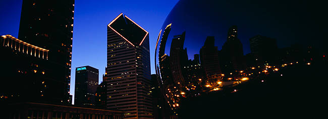 Low angle view of reflections of lit up buildings in a sculpture, Cloud Gate, Millennium Park, Chicago, Illinois, USA