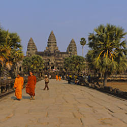 Two monks walking in front of an old temple, Angkor Wat, Siem Reap, Cambodia