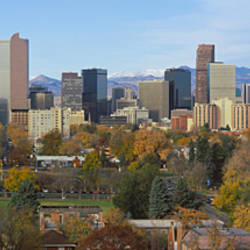 Skyscrapers in a city with mountains in the background, Denver, Colorado, USA