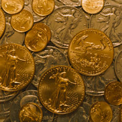 Close-up of assorted gold and silver coins, Sacramento, California, USA