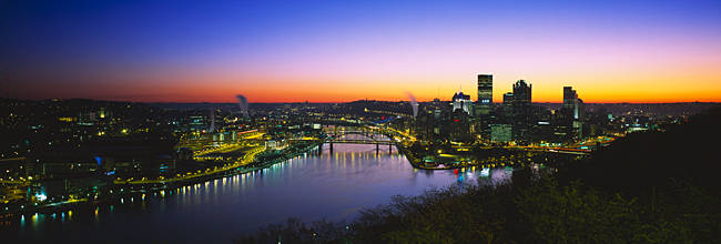 Buildings lit up at dawn, Pittsburgh, Pennsylvania, USA