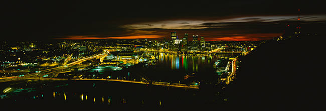 High angle view of buildings lit up at dawn, Pittsburgh, Pennsylvania, USA