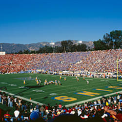 High angle view of spectators watching a football match in a stadium, Rose Bowl Stadium, Pasadena, California, USA