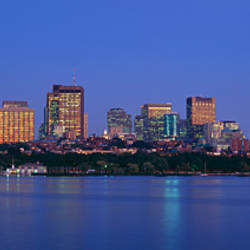 Buildings at the waterfront lit up at night, Boston, Massachusetts, USA