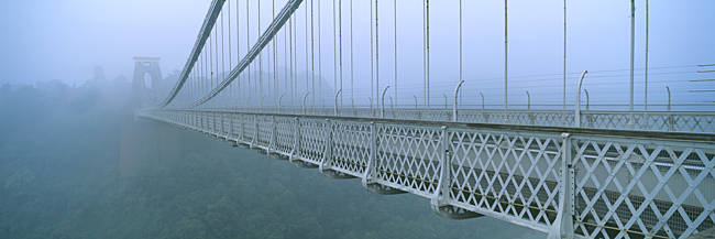 Fog covered bridge across a river, Clifton Suspension Bridge, Bristol, England