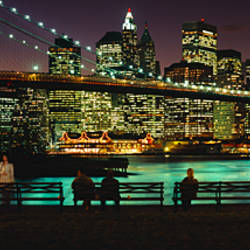 Suspension bridge lit up at dusk, Brooklyn Bridge, East River, Manhattan, New York City, New York State, USA