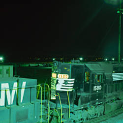 Cargo containers and a train engine in a shunting yard
