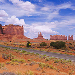 Road passing through a desert, Monument Valley Tribal Park, USA