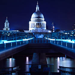 Bridge lit up at night, Millennium Bridge, Thames River, St Paul's Cathedral, London, England