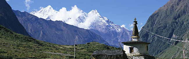 Nepal, Manaslu Trek, Chorten, View of a temple at the base of a mountain