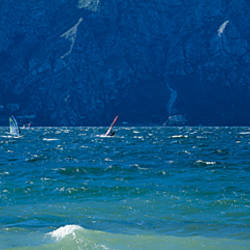 Side profile of a person windsurfing, Lake Garda, Italy