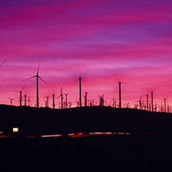 Wind turbines in a row at dusk, Palm Springs, California, USA