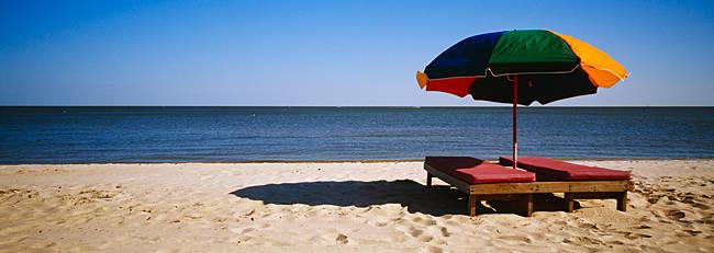Two beach beds under an umbrella on the beach, Biloxi, Mississippi, USA